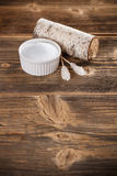 Xylitol. In white bowl on old wooden background stock photography
