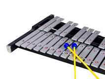Xylophone with mallets on isolated white background. Selective focus Stock Photos