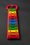 Xylophone metallophone for kids on dark grey Royalty Free Stock Photos