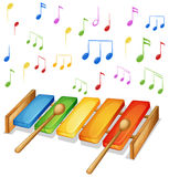 Xylophone with music notes background Royalty Free Stock Image
