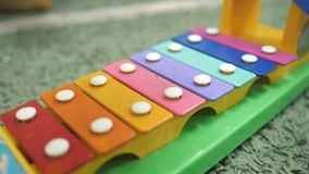 Xylophone toy in rainbow color. Education toy for kid and toddler. Slow motion stock video footage