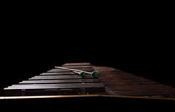 Xylophone with two mallets. Dark background. Close-up Royalty Free Stock Photo