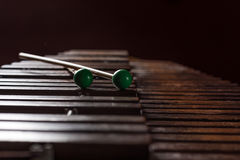 Xylophone with two mallets. Dark background. Close-up Stock Images