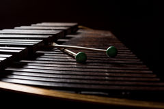 Xylophone with two mallets. Dark background. Close-up Stock Photo