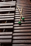 Xylophone with two mallets. Dark background. Close-up Stock Photos