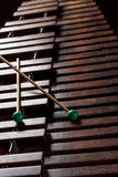 Xylophone with two mallets. Dark background. Close-up Royalty Free Stock Images
