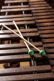 Xylophone with two mallets. Dark background. Close-up Royalty Free Stock Photos