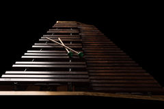 Xylophone with two mallets. Dark background. Close-up Stock Image