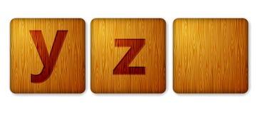 Y,Z阻拦木象 与信件的字母表立方体 库存照片