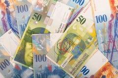 100 y 50 billetes de banco del suizo del CHF Imágenes de archivo libres de regalías