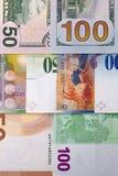 100 y 50 dólares del euro, fondo del franco suizo Fotos de archivo
