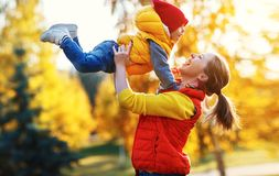 Y family mother and baby son on autumn walk. Happy family mother and baby son playing and laughing on autumn walk royalty free stock photography