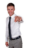Y hand specifying. Young businessman does gesture by a hand specifying, isolated on a white background Royalty Free Stock Images