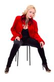 Y model wearing fur coat  sitting on chair Royalty Free Stock Photography