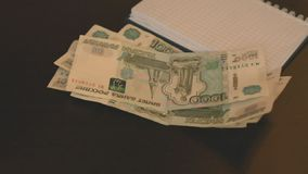 Y-shaped russian rubles bundles flow with slow motion. Wealth and money. Close up stock video