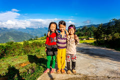 Y TY, LAOCAI, VIETNAM - SEPTEMBER 7, 2014 - Unidentified ethnic children enjoying happily posing on the road. royalty free stock photography