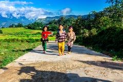 Y TY, LAOCAI, VIETNAM - SEPTEMBER 7, 2014 - Unidentified ethnic children enjoying happily posing on the road. stock photos