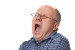 Yaaaaawn. Bald senior man yawns. Emotional portraits series. Isolated on white Royalty Free Stock Photos