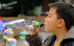 Yaan China-A boy like blowing soap bubbles. At Peach Hill in Yaan,a little boy is continually blowing soap bubbles.Yaan China-Danchayuan photo royalty free stock photos
