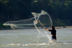 Yaan China-A net fishing man in Qingyi River. A fishing man in Qingyi River throwing fishing net under the sun,yaan China-Danchayuan photo Royalty Free Stock Photos