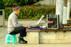 Yaan China-An old man is playing electronic organ Stock Images