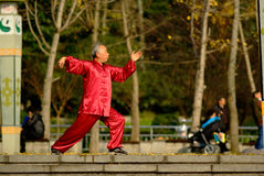 Yaan China-An old man is playing Taijiquan. In winter,an old man is playing Taijiquan in the sanya park, a good mental state.Yaan Sichuan China-Danchayuan photo Royalty Free Stock Photo