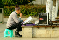 Yaan China-An old man is singing Stock Images