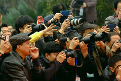 Yaan China-Some peoples eagerly snapping photos Royalty Free Stock Photos