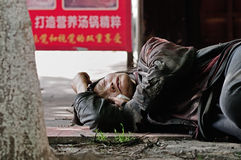 Yaan China-A wanderer is sleeping. Royalty Free Stock Photo
