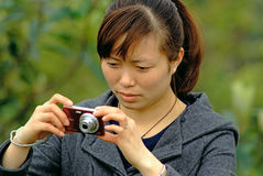Yaan China-A women is taking photos Stock Image