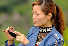 Yaan China-A women is taking photos Stock Images