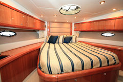 Yacht. A luxury yacht bedroom - Luxury concept Royalty Free Stock Photo