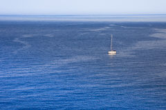 Yacht. Lonely boat on the background of the high seas Stock Image
