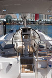 Yacht. A moored yacht in a marina showing the helm Royalty Free Stock Photography
