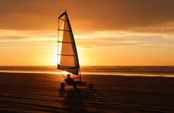Yacht. Land yacht zooming along the beach at sunset Stock Photos