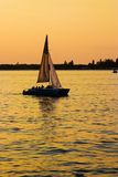 Yacht. Leisure series: yacht in the sea gulf in evening sunset Royalty Free Stock Images