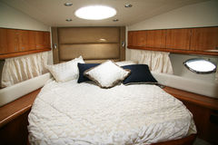 On a yacht. Magnificent bedroom on a yacht Stock Photo