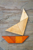 Yacht abstrait de puzzle de tangram Photographie stock
