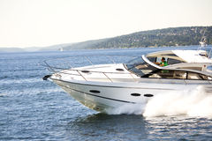 Yacht action in Norwegian fjord. A yacht speeds by in the Oslo Fjord, Norway, the summer of 2009 Stock Images