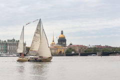 Yacht against the backdrop of Dvortsovaya Embankment. Royalty Free Stock Images