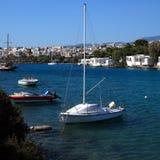 Yacht and Agios Nikolaos City, Crete Stock Images