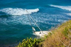 A yacht aground on a reef in the caribbean Stock Photos