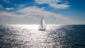 Yacht alone. In the middle of the sea Stock Image