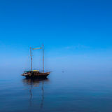 Yacht alone. On the sea with blue sky Royalty Free Stock Images