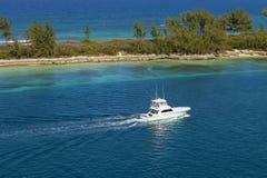 Yacht along Bahamas coastline Royalty Free Stock Images