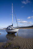Yacht at anchor. In Red Wharf Bay, Anglesey at low tide Royalty Free Stock Photography