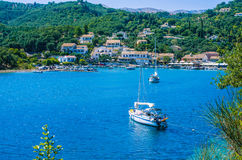 Yacht at anchor in front of Agios Stefanos, Corfu, Greece.  Stock Photography