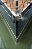 Yacht and anchor. Yacht with anchor hanging in front Royalty Free Stock Photography