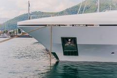Yacht and anchor. In marina Stock Photos