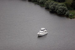 Yacht at anchor. Moscow river  yacht standing anchored not far from shore Royalty Free Stock Image
